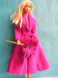 Barbie doll with a Barbie pink coat