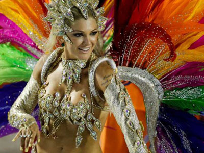 Samba dancer with pink and multicolored feather headdress at the Carnival of Rio de Janeiro