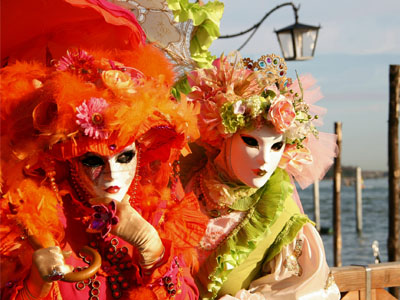Pair of costumed and masked party-goers at the Carnival of Venice