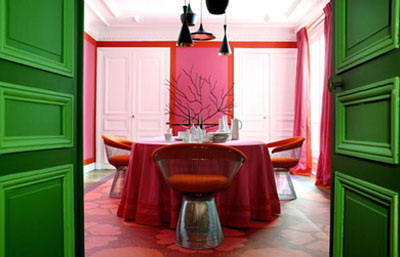 Home of interior designer Christophe d'Aboville in Paris with bright pink walls and green doors