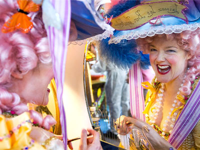 Party-goer with pink baroque wig at Mardi Gras parade in New Orleans