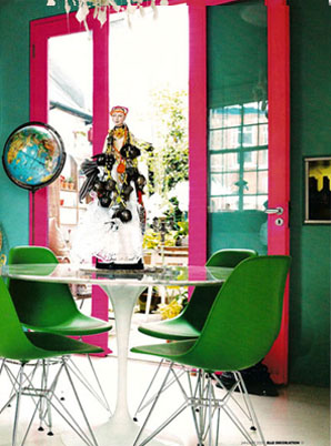 Home of fashion designer Matthew Williamson with green walls and bright pink doors