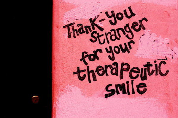 Graffiti on a pink wall in London
